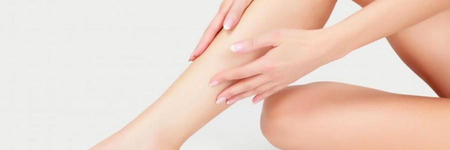 woman-touching-leg