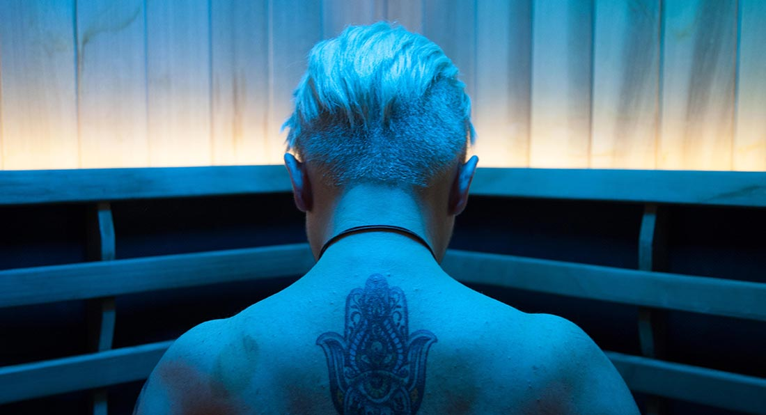 Woman in Perspire Sauna Studio Blue Color light therapy Sauna