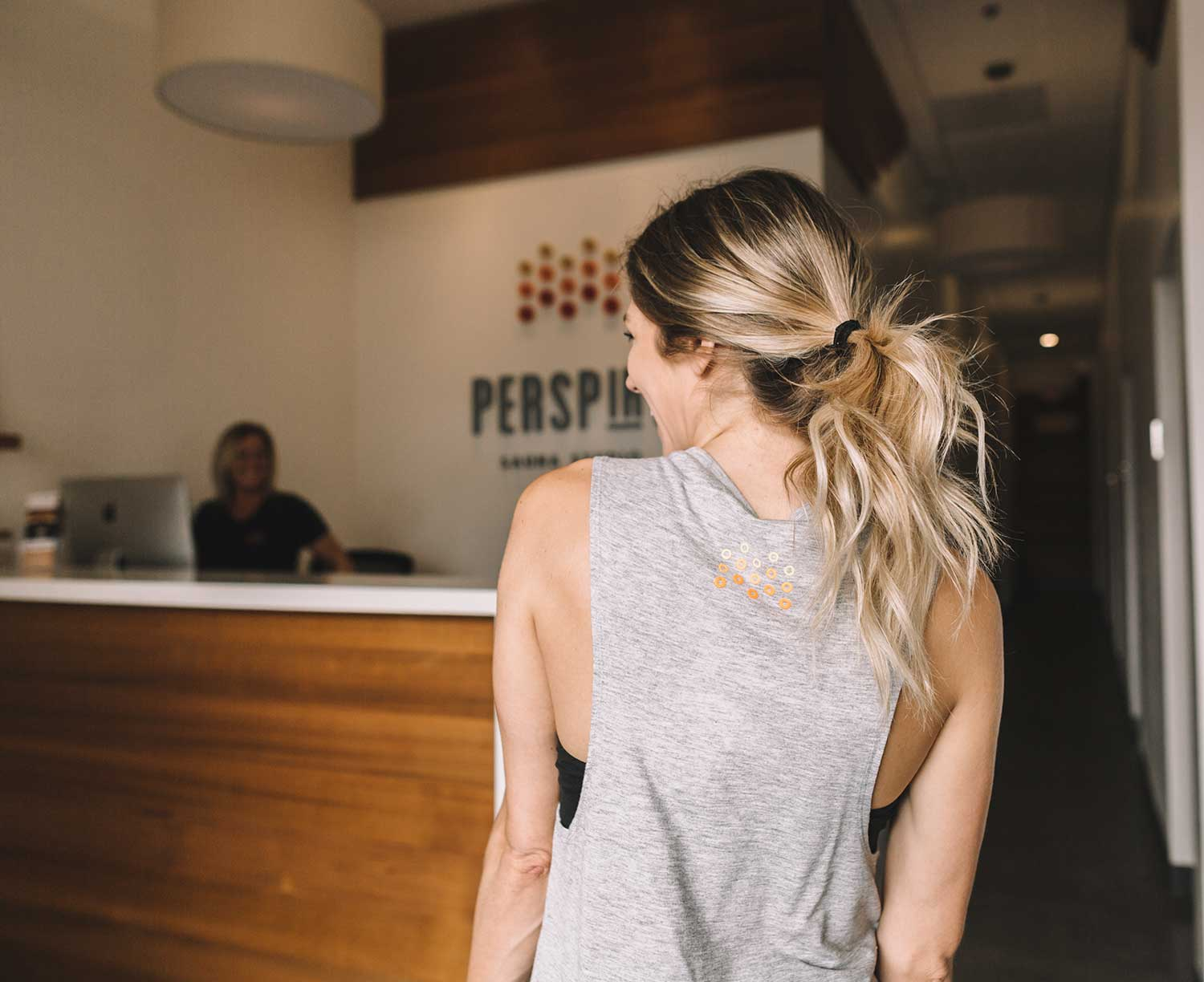 woman walking into perspire sauna studio in Laguna Niguel