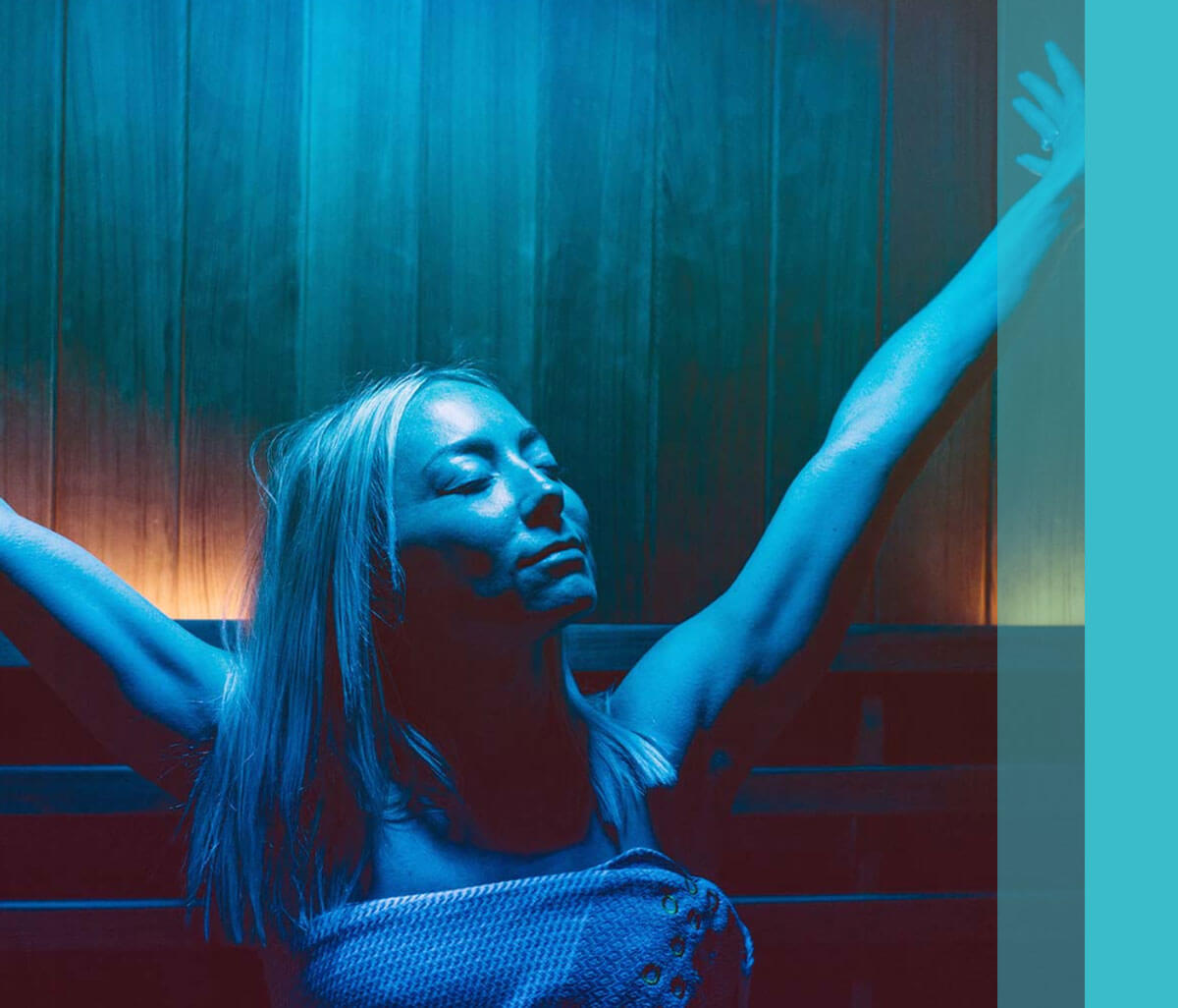 Woman stretching in blue light therapy sauna